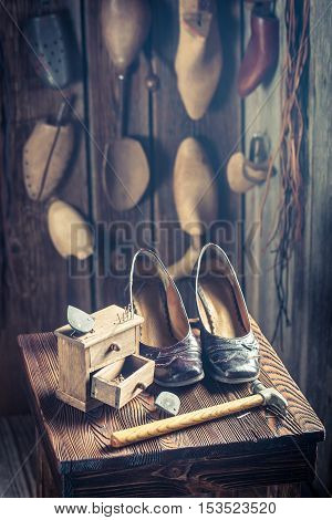 Old Cobbler Workshop With Shoes, Laces And Tools