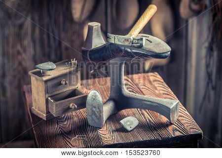 Old Cobbler Workplace With Tools, Shoes And Leather