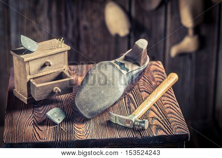 Aged Shoemaker Workplace With Tools, Shoes And Laces