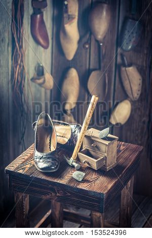 Aged Shoemaker Workplace With Tools, Shoes And Leather