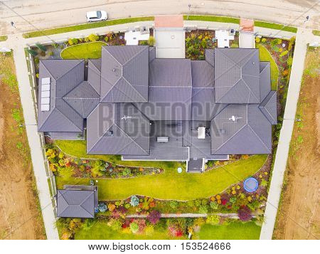 Aerial view of house with beautiful garden. Czech village from above. Urban landscape in European Union.