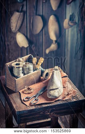 Small Shoemaker Workplace With Brush And Shoes
