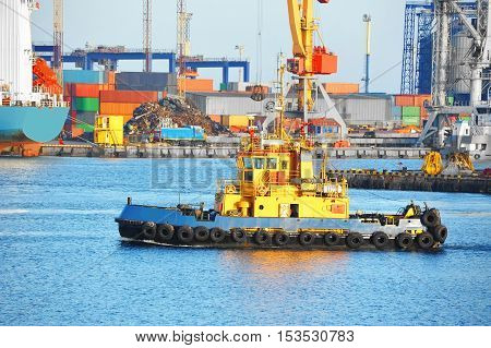 Tugboat and crane in harbor quayside on Odessa Ukraine