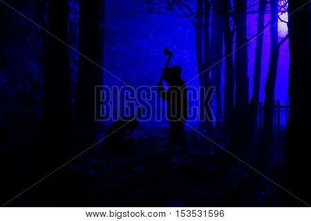 Murder in the park. Maniac swings ax on his prey. Maniac kills his victim in the night deserted park. Silhouettes in night foggy forest