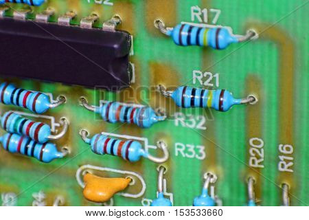 Circuit board with electronic components taken closeup.