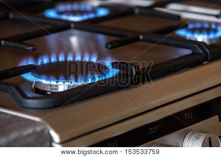 Burning blue burners on a metal cooker