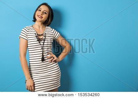 Portrait Of Smiling Woman Fashion On Blue Background