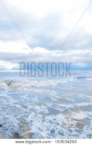 waves and colored splashes of sea on the beach