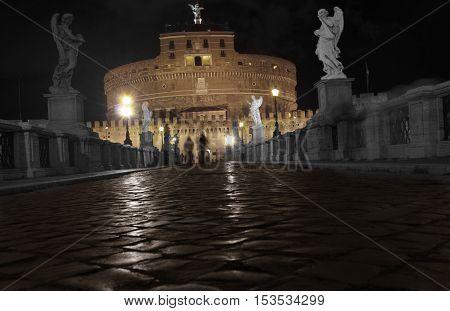 Saint Angel castle by night in Rome