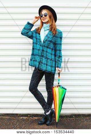 Fashion Pretty Young Smiling Woman With Colorful Umbrella Wearing A Black Hat Checkered Coat Jacket