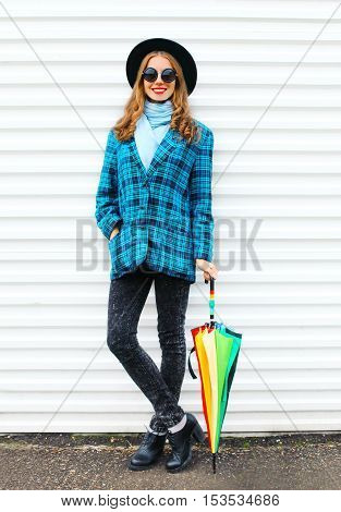 Pretty Young Smiling Woman With Colorful Umbrella Wearing Fashion Black Hat Checkered Coat Jacket Ov