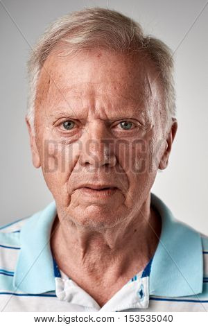 Portrait of real old white caucasian man with no expression ID or passport photo full collection of diverse face and expressions