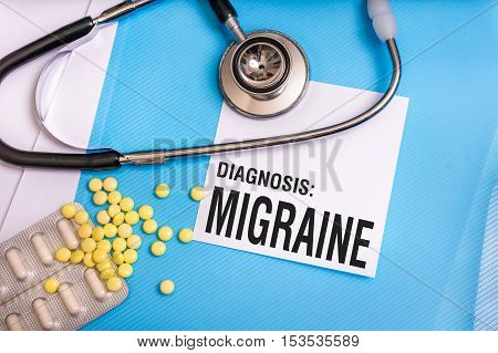 Migraine Word Written On Medical Blue Folder With Patient Files