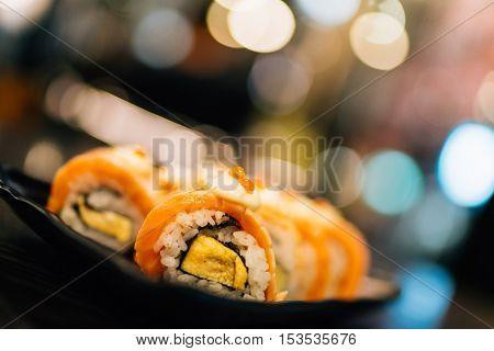 Salmon sushi or salmon roll beautiful blur bokeh background depth of field effect