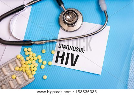 Hiv Word Written On Medical Blue Folder With Patient Files