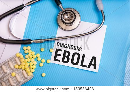 Ebola Word Written On Medical Blue Folder With Patient Files