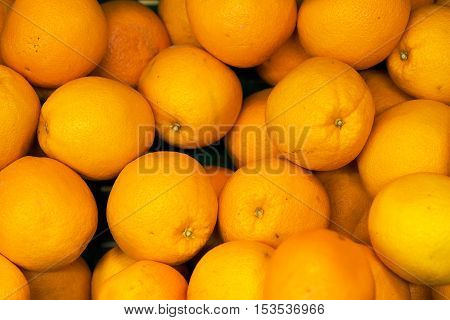 Lots of bright oranges in supermarket. Closeup view