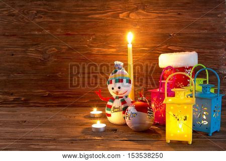 Handmade Snowman, Lamp With A Candle And Christmas Decoration.