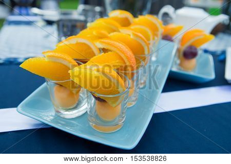 fruit and egg yoke fudge balls cooked in syrup in party