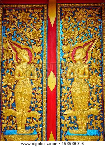 Ancient Golden carving wooden window of Thai temple that created with money donated by people to hire artist no restrict in copy or use