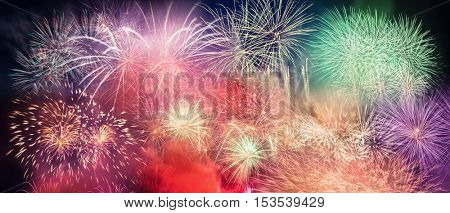 Spectacular fireworks show light up the sky. New year celebration panoramic background. Huge resolution, very detailed.