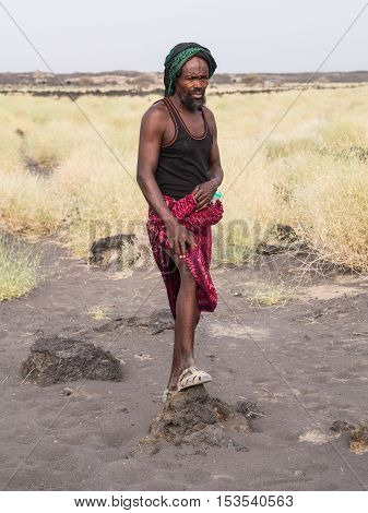 ERTA ALE ETHIOPIA - JUNE 28 2016: Local tourist guide leading a group down from Erta Ale active volcano in Afar Region in Ethiopia Africa