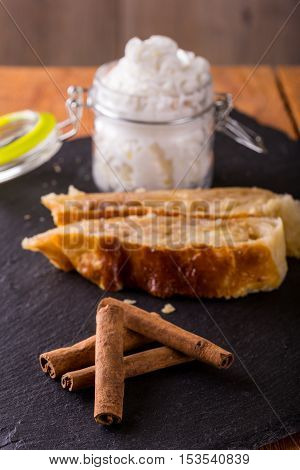 Four Pieces Of Cinnamon In Front Of Apple Pie