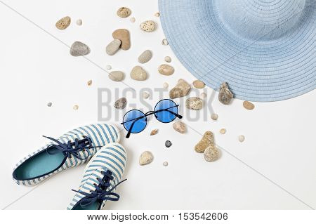 Fashion accessories in blue colors - hat shoes and glasses.