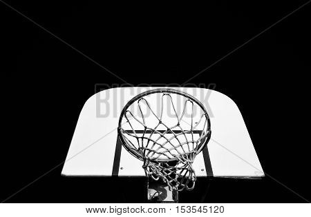 An outdoor basketball net and backboard in black and white
