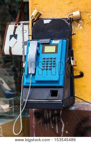 old pay telephone on a city street