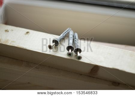 the dowels lying on a wooden Board