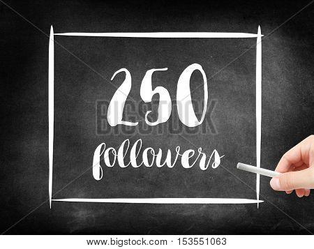 250 followers written on a blackboard