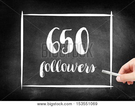 650 followers written on a blackboard