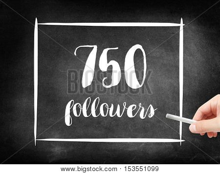 750 followers written on a blackboard