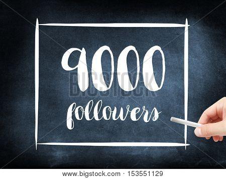 9000 followers written on a blackboard