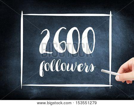 2600 followers written on a blackboard