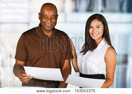 Minority workers together in their office working