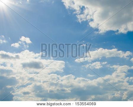 sunny day - beautiful blue sky with shining sun and clouds. sunlight. summer season landscape. warm dry calm weather.