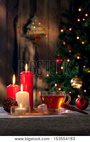 close up view of cup of black tea and candle on color back