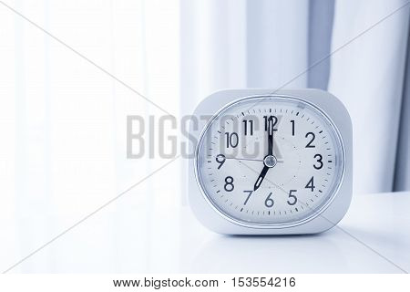 White Square Clock On White Bed Stand With White Curtain Background, Morning Time In Minimal Style D