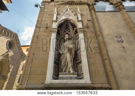 FLORENCE, ITALY - SEPTEMBER 2016 : Marble statue of Saint Peter (Guild of Butchers) by Donatello, Orsanmichele church exterior, 1 of 14 external niche figures in Florence, Italy on September 21, 2016