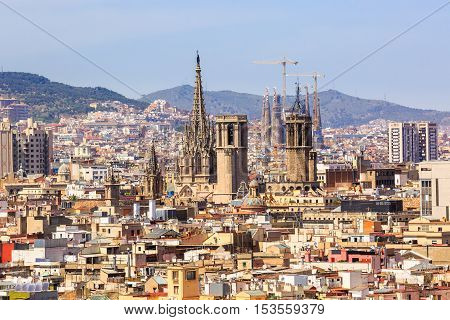 Barcelona, Spain - May 27, 2016: aerial view of Barcelona churches, La Cathedral de la Santa Cruz y Santa Eulalia, residence of the Archbishop  and the main cathedral of Barcelona, and Sagrada Familia