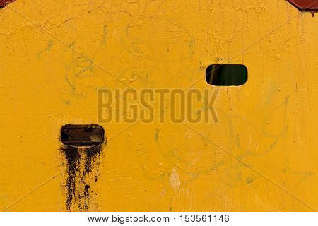 Yellow Textured Wall With Holes
