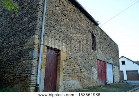 Old sizes of stone barn with garage doors