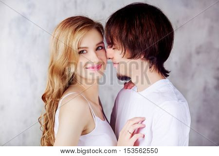 happy young couple against studio background