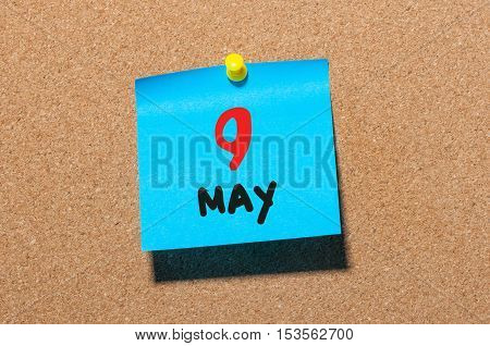 May 9th. Day 9 of month, calendar on cork notice board, business background. Spring time, empty space for text.