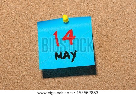 May 14th. Day 14 of month, calendar on cork notice board, business background. Spring time, empty space for text.