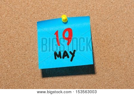 May 19th. Day 19 of month, calendar on cork notice board, business background. Spring time, empty space for text.