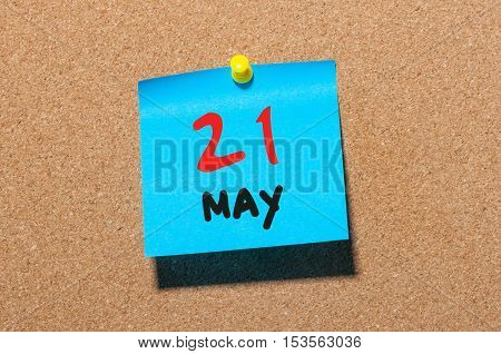 May 21st. Day 21 of month, calendar on cork notice board, business background. Spring time, empty space for text.