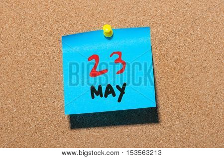 May 23rd. Day 23 of month, calendar on cork notice board, business background. Spring time, empty space for text.